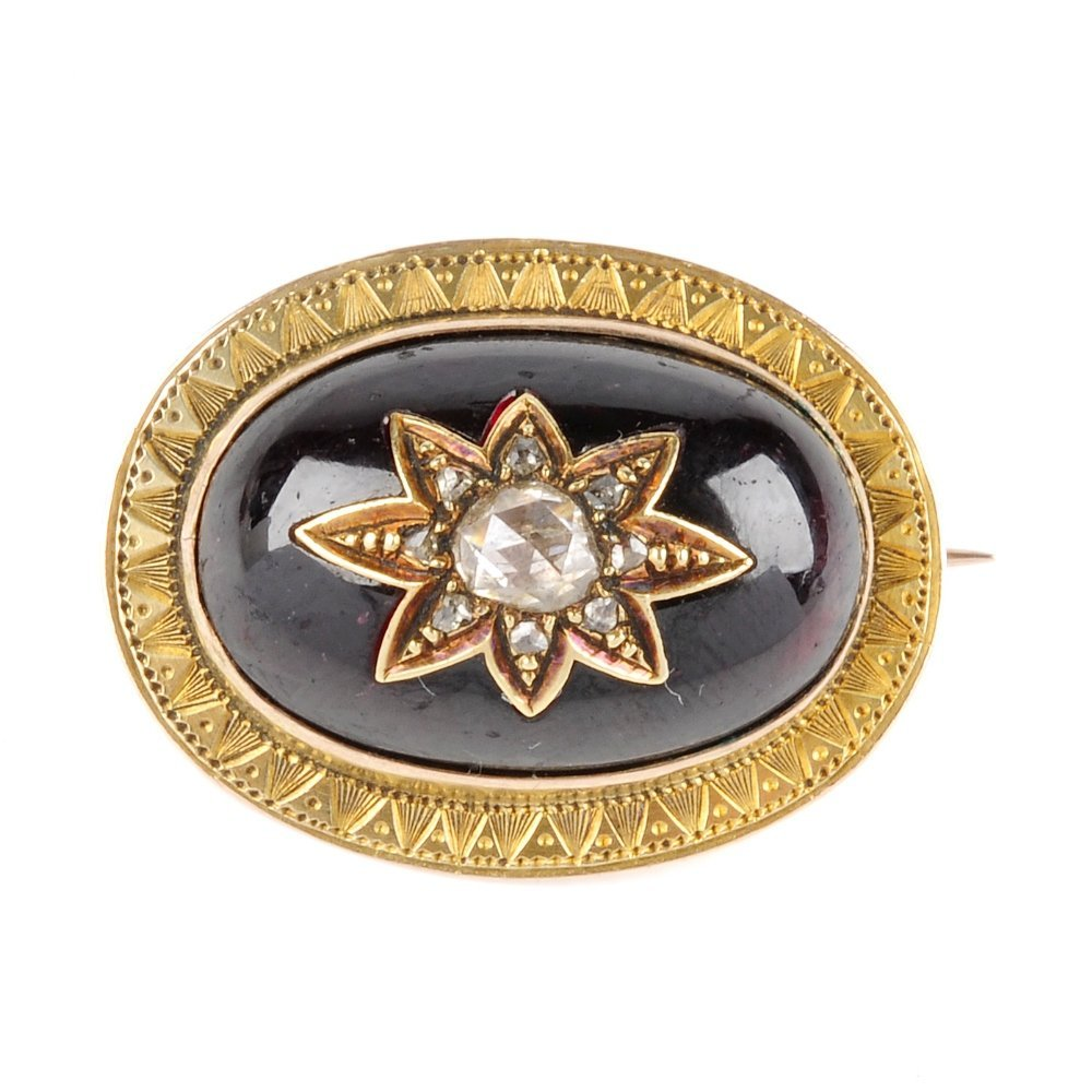A late 19th century gold, garnet and diamond brooch.