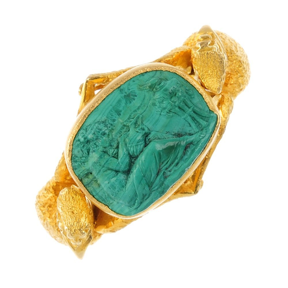 A late 19th century 18ct gold carved malachite ring.