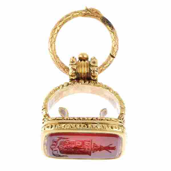 A late 19th century gold carved carnelian intaglio fob.