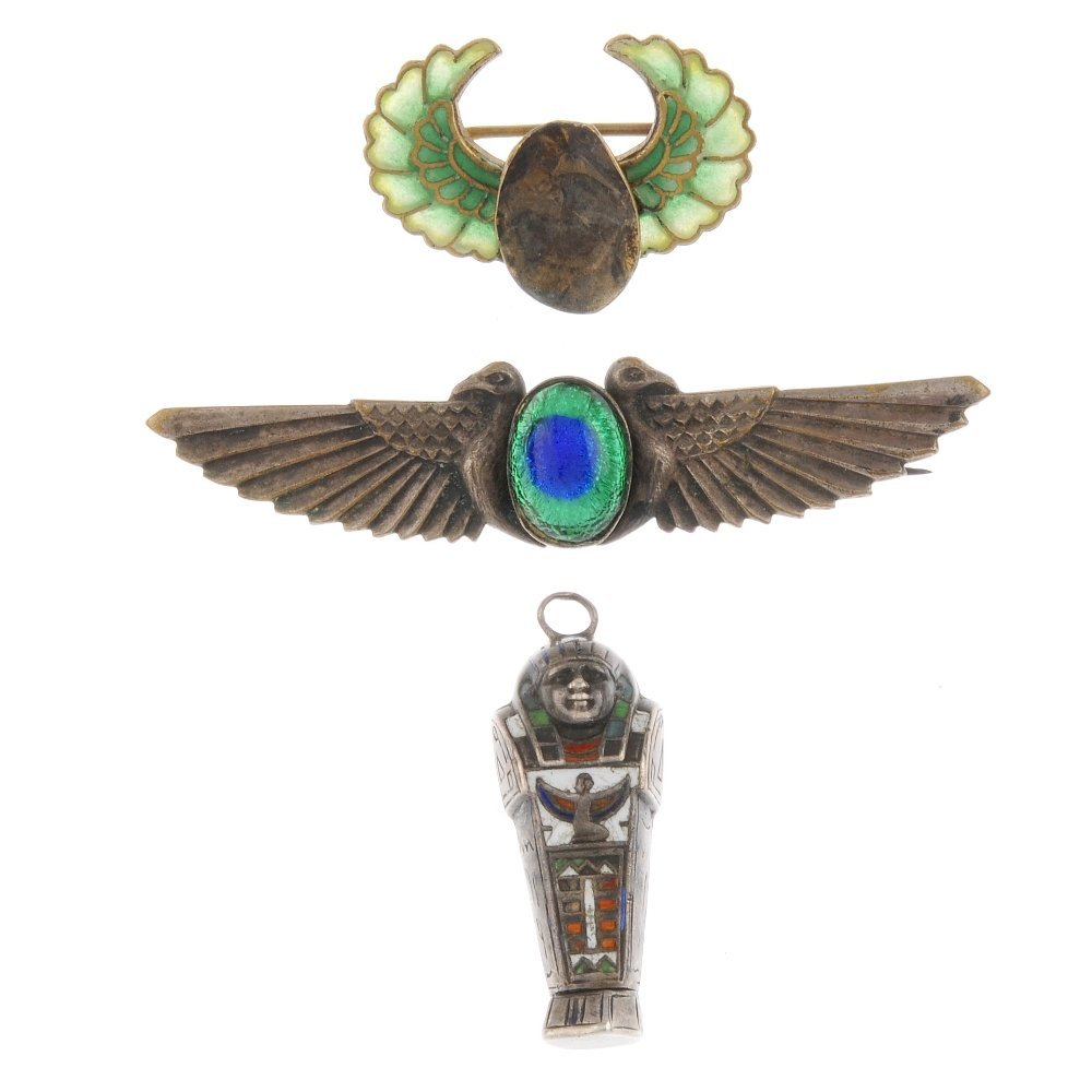 Two Egyptianesque brooches and a pendant. The first