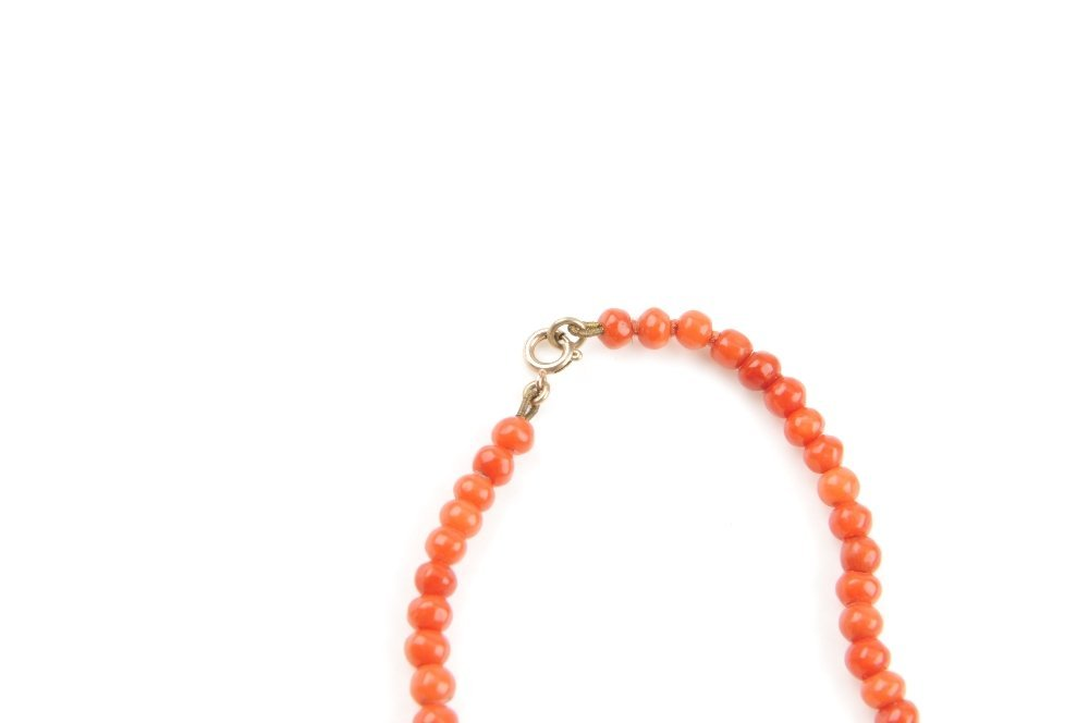 A coral bead necklace. Designed as a single-row of - 2