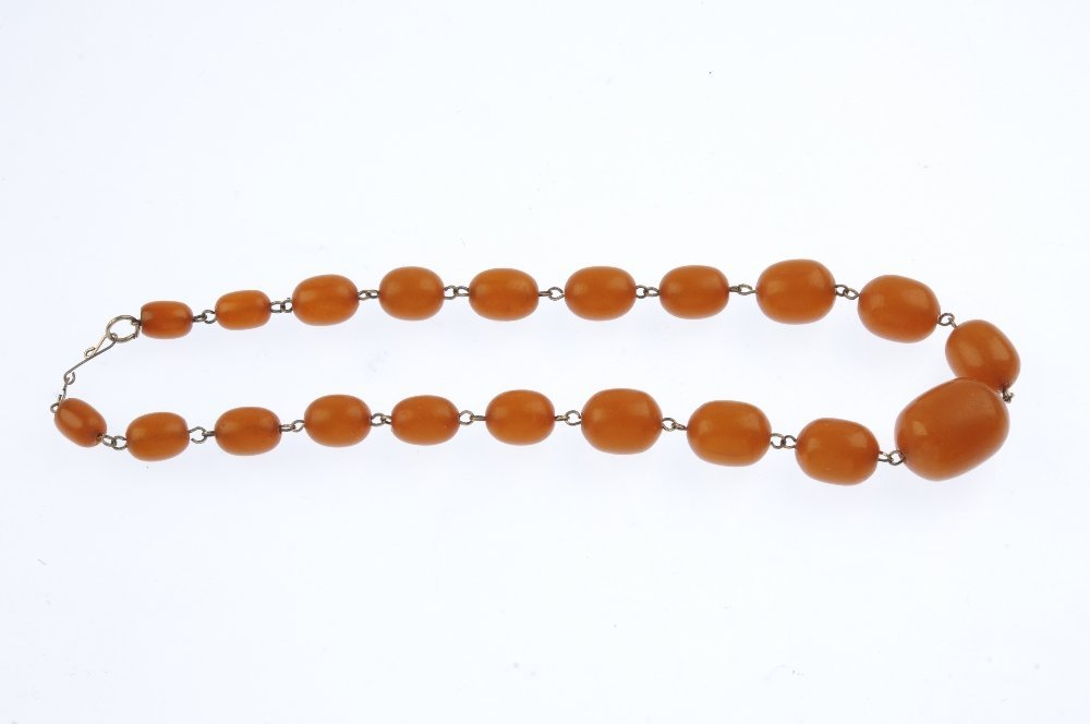 A reconstructed amber bead necklace. Designed as - 2