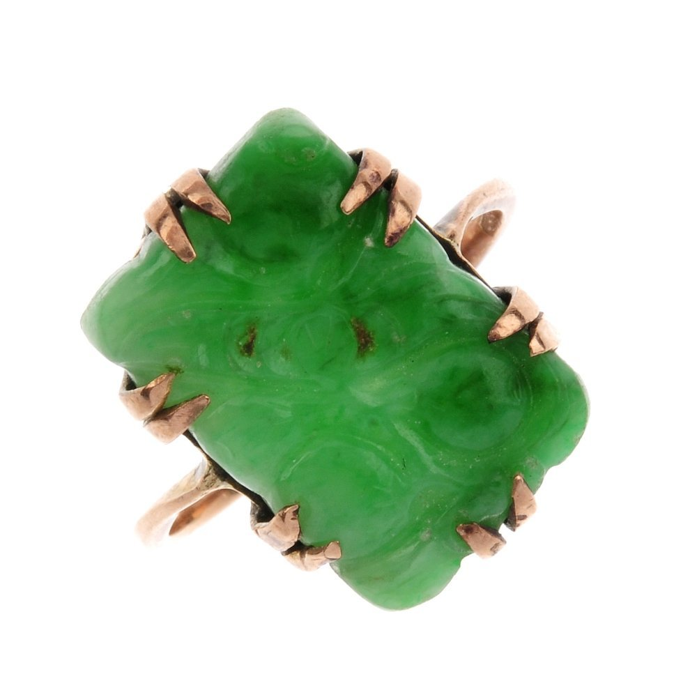 A carved jade ring. The rectangular jade panel, carved