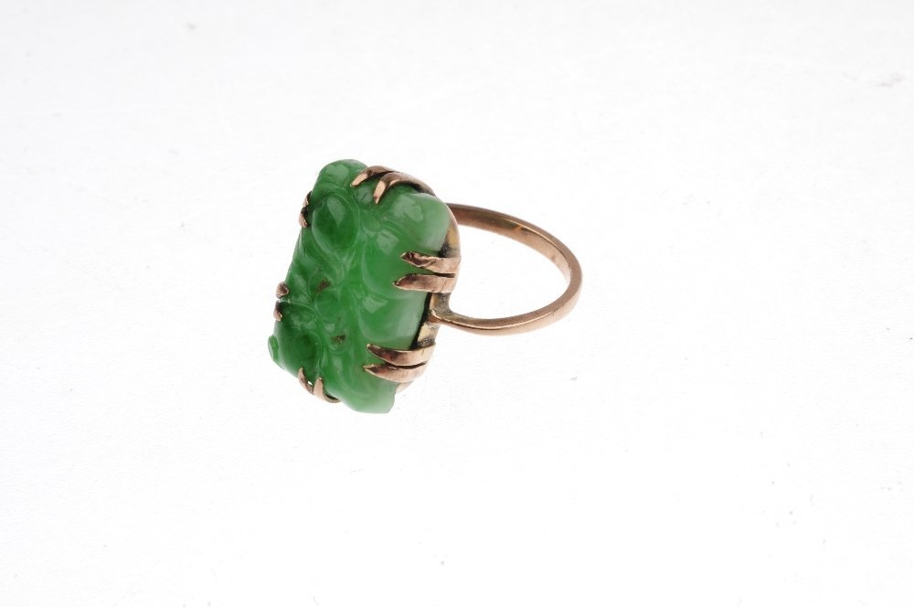 A carved jade ring. The rectangular jade panel, carved - 3