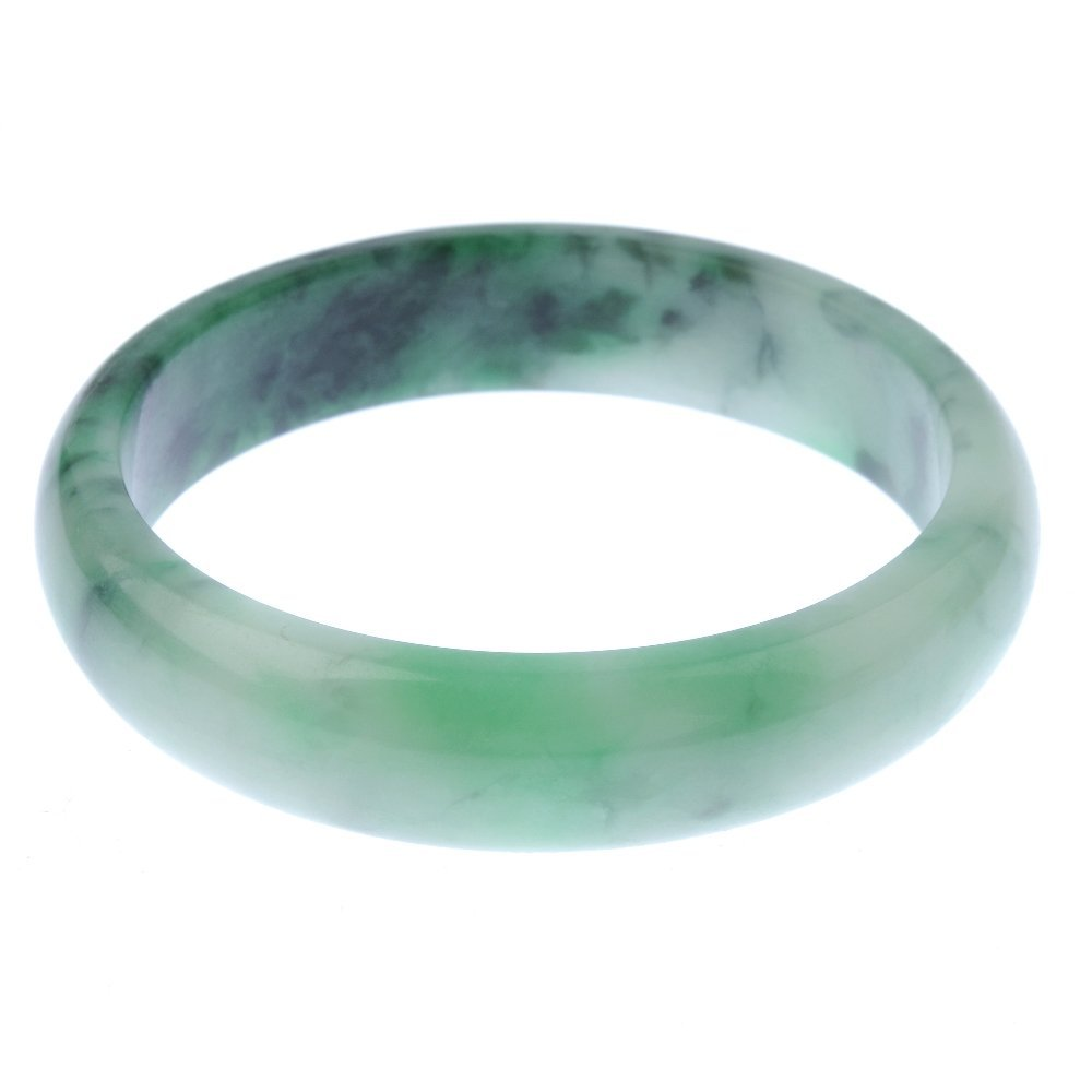 Two gem bangles. To include a plain D-shape jade bangle