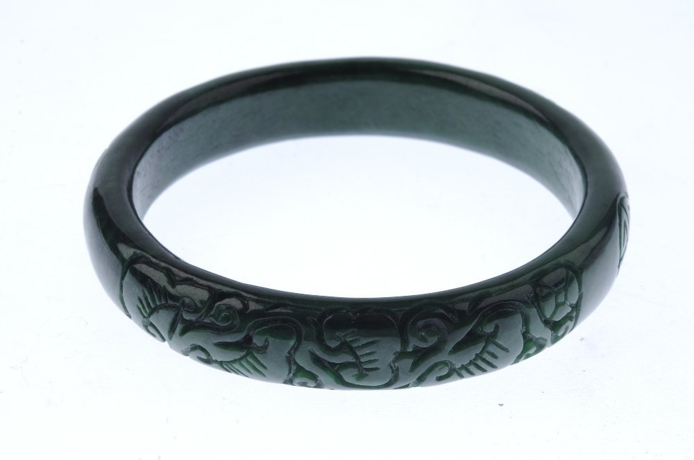 Two gem bangles. To include a plain D-shape jade bangle - 3