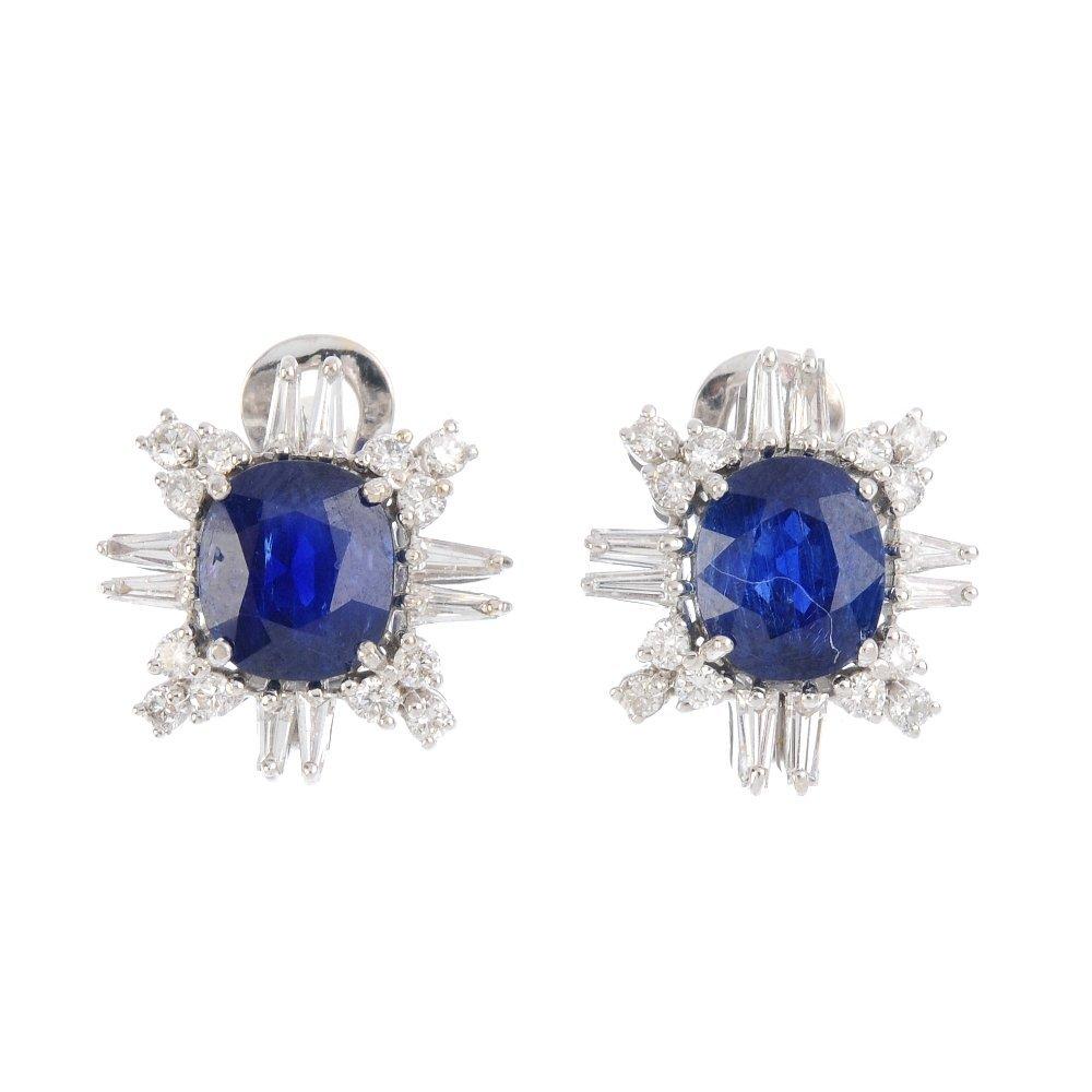 A pair of Burma sapphire and diamond earrings. Each