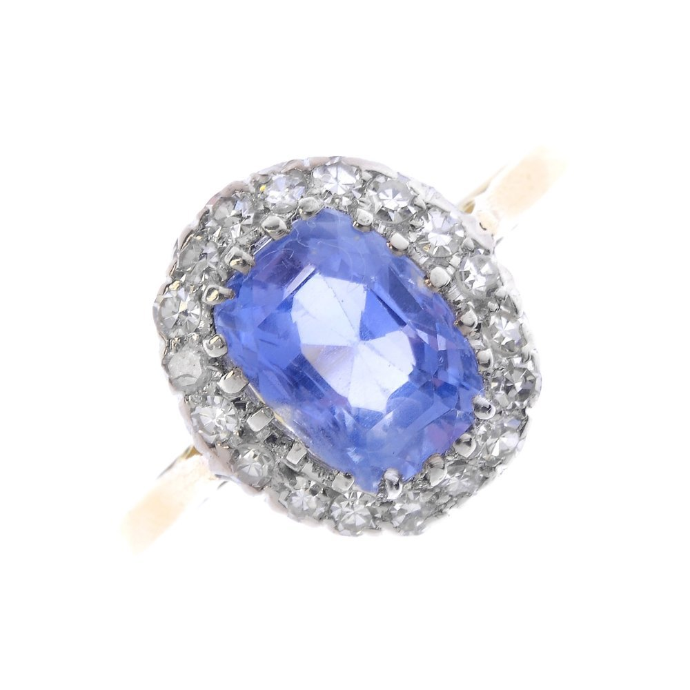 A Ceylon sapphire and diamond cluster ring. The