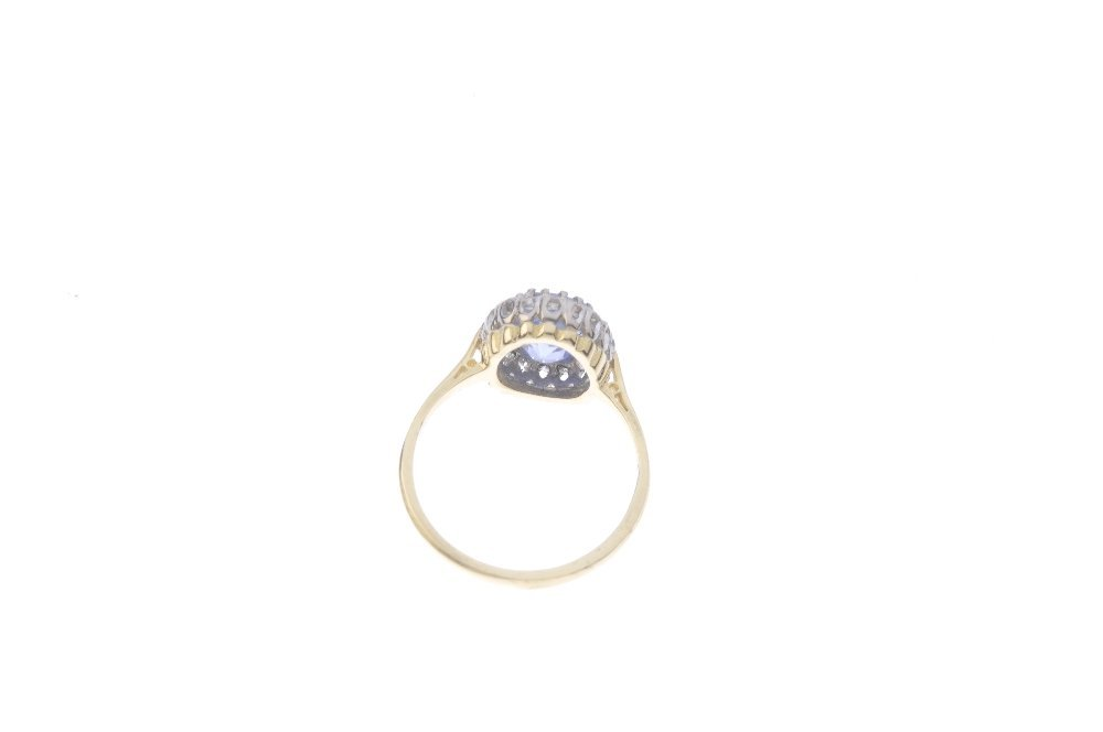 A Ceylon sapphire and diamond cluster ring. The - 3