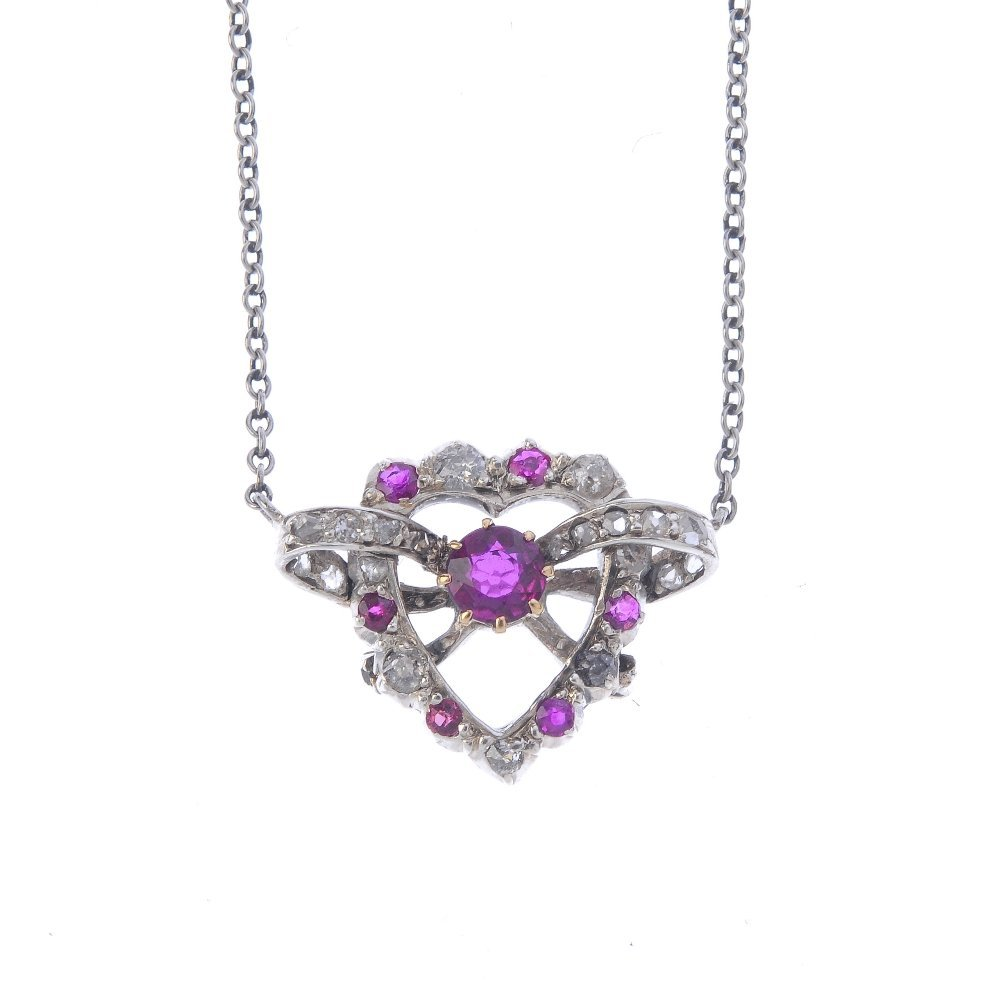 A diamond and ruby pendant. Designed as a