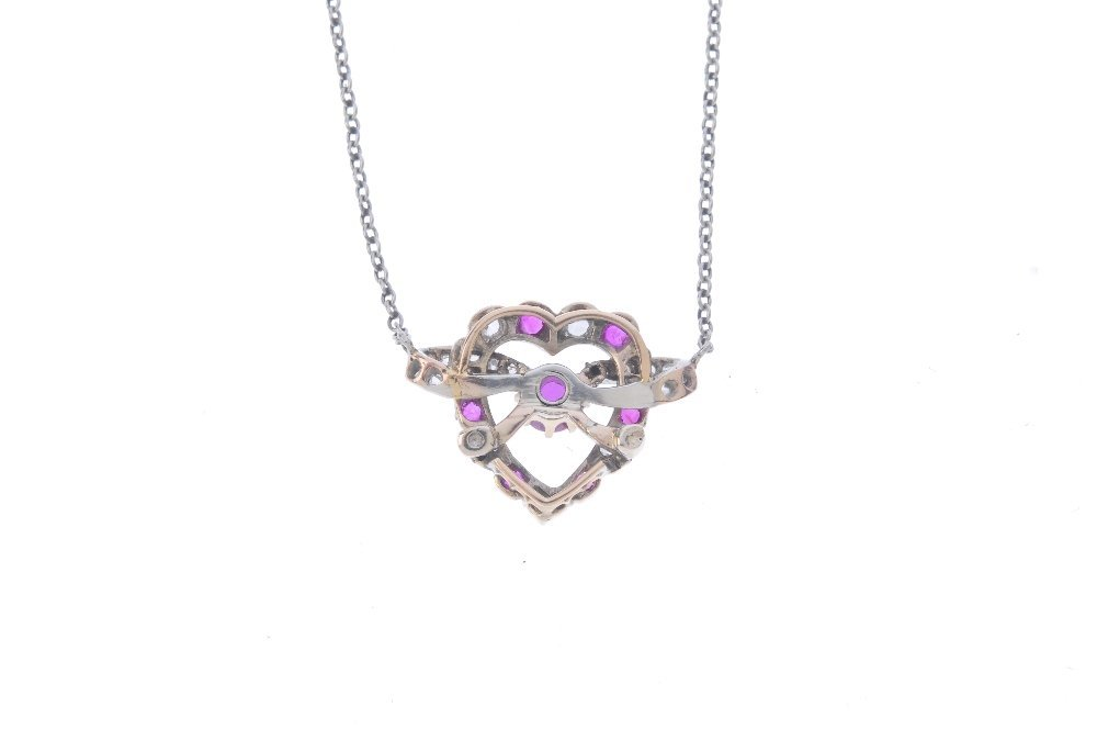 A diamond and ruby pendant. Designed as a - 2