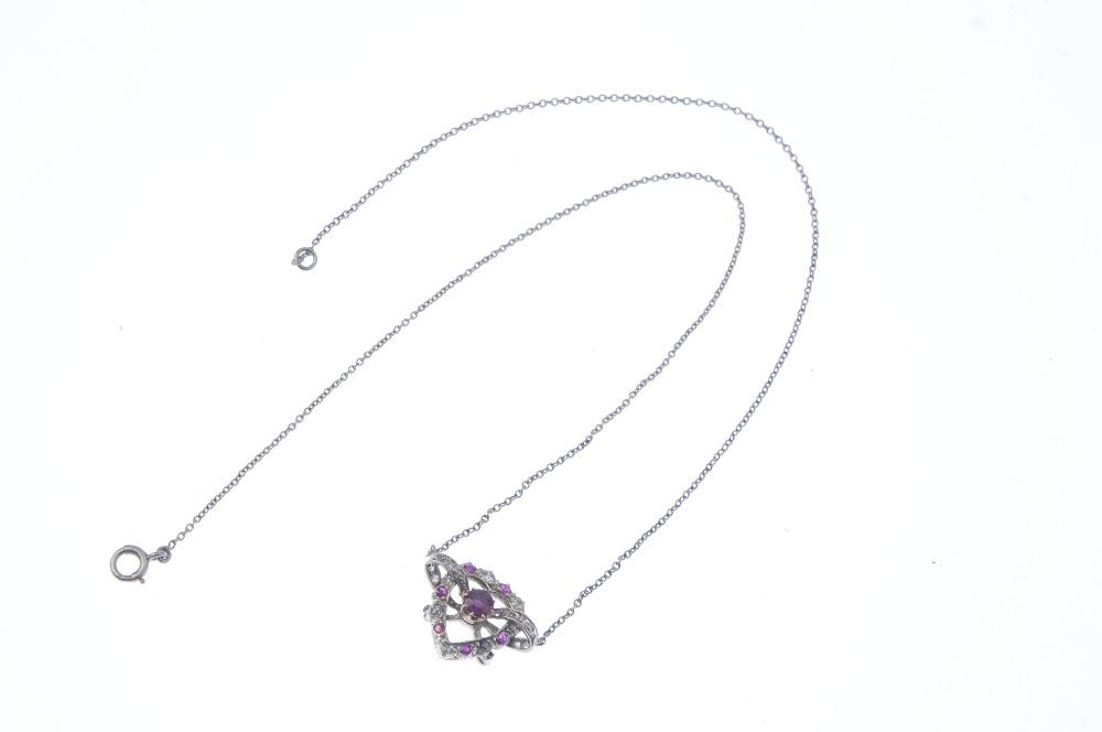A diamond and ruby pendant. Designed as a - 3