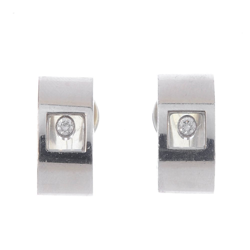 CHOPARD - a pair of 'Happy Diamond' earrings. Each