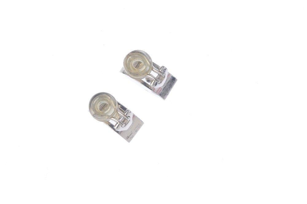 CHOPARD - a pair of 'Happy Diamond' earrings. Each - 2