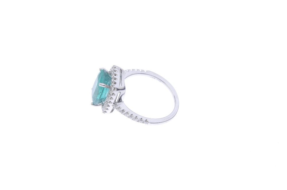 An emerald and diamond cluster ring. The cushion-shape - 2