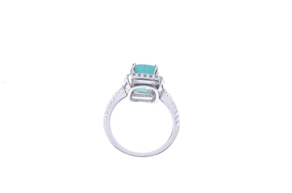 An emerald and diamond cluster ring. The cushion-shape - 3