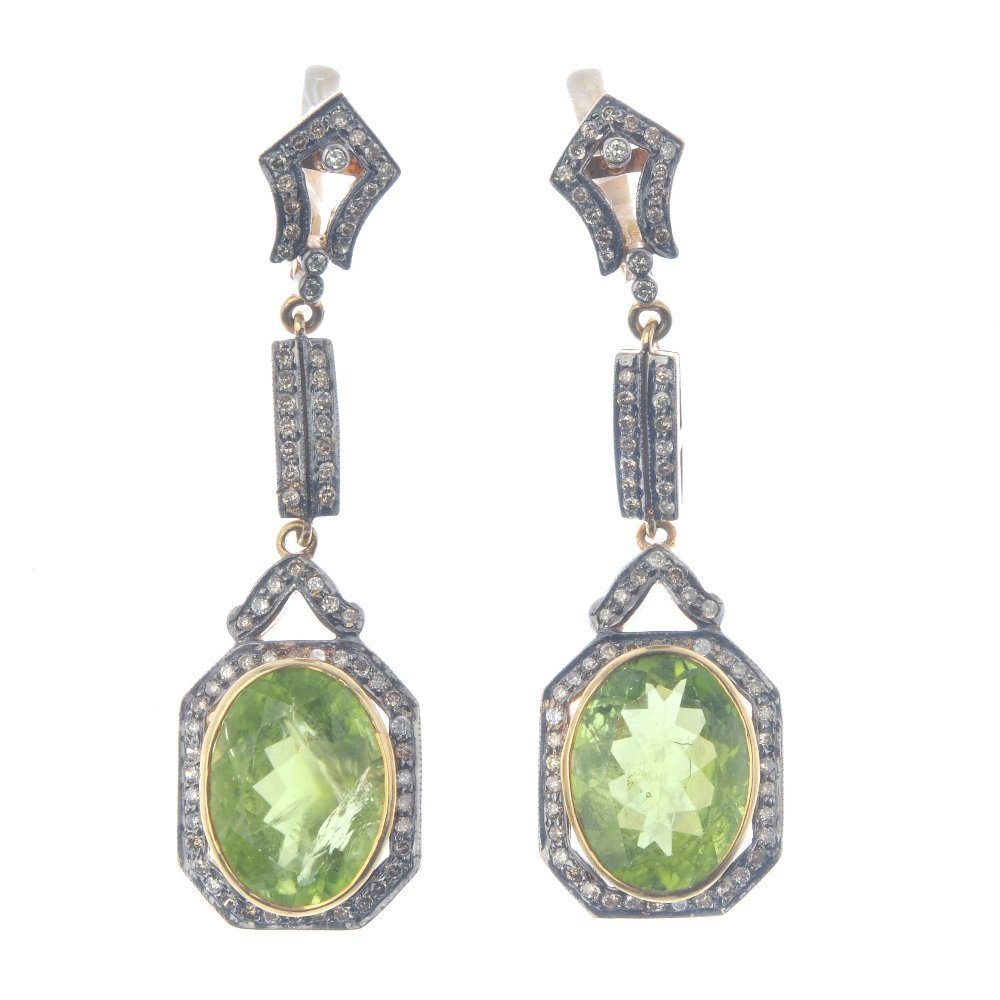 A pair of peridot and diamond earrings. Each designed