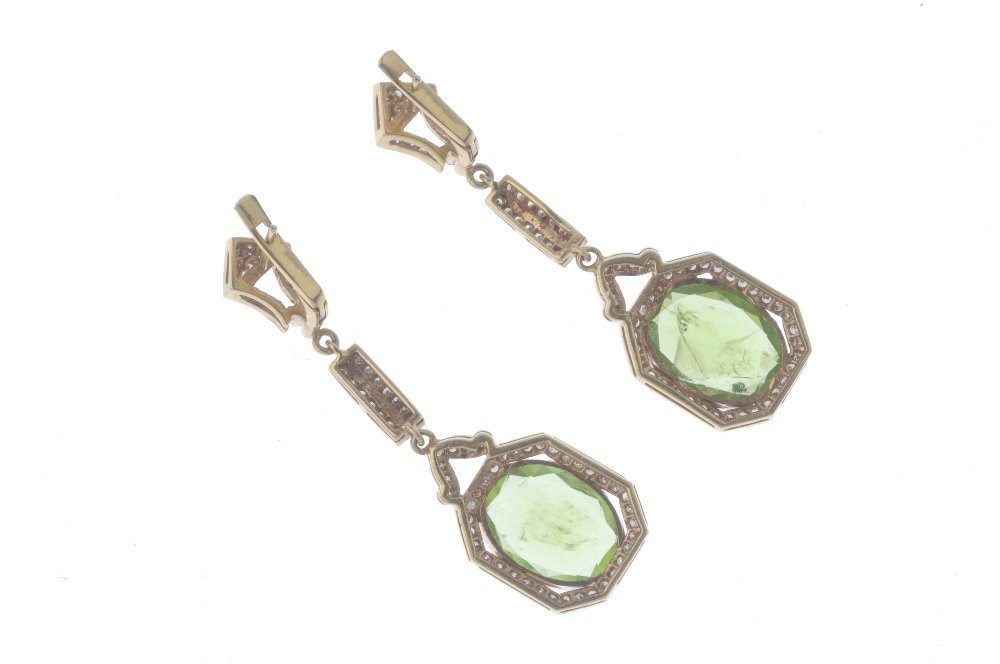 A pair of peridot and diamond earrings. Each designed - 2