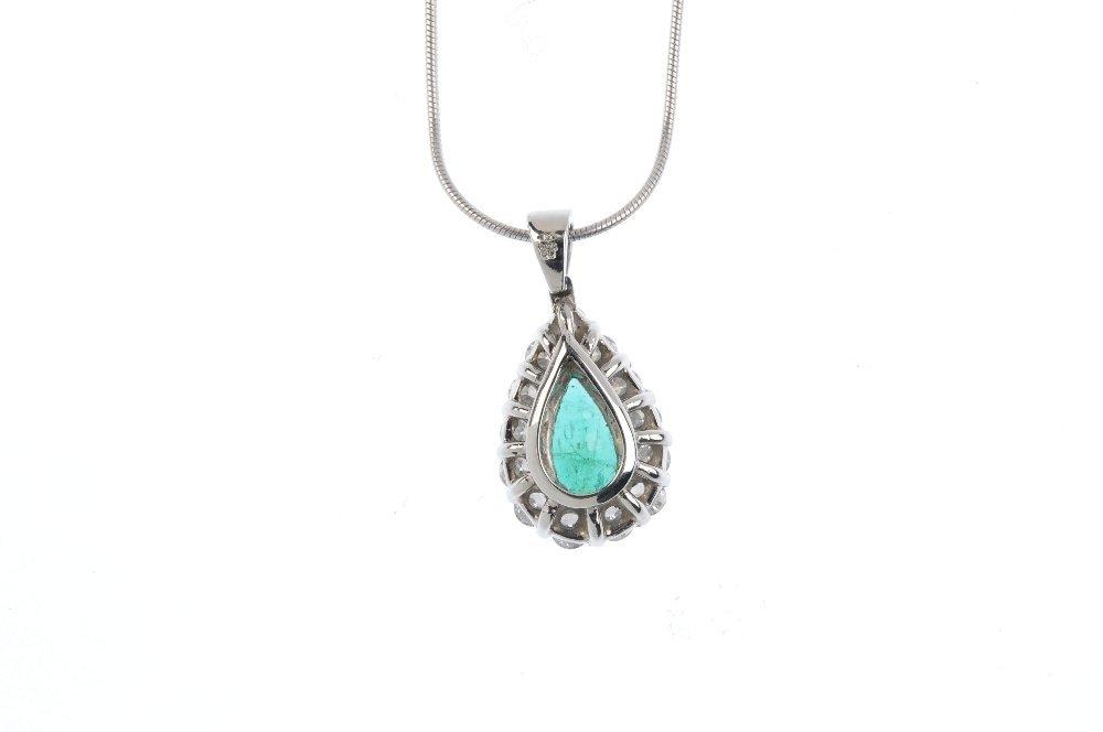 A platinum, emerald and diamond cluster pendant. The - 2