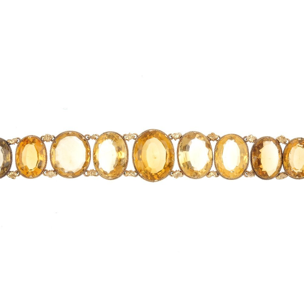 A late Victorian gold citrine bracelet. The graduated