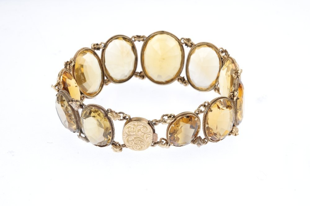 A late Victorian gold citrine bracelet. The graduated - 3