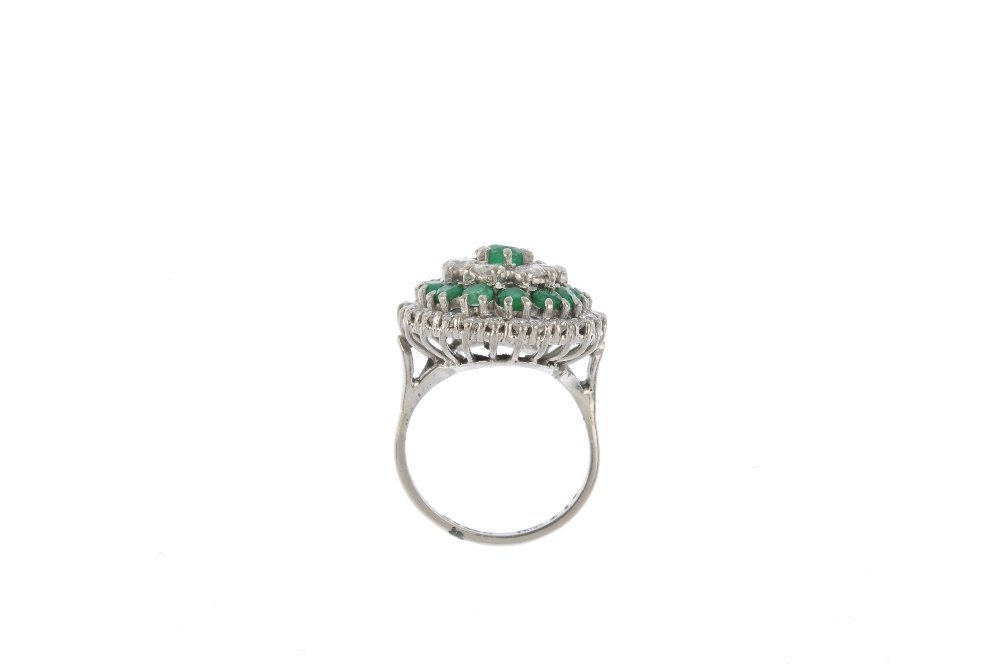 An 18ct gold diamond and emerald cluster ring. The - 2