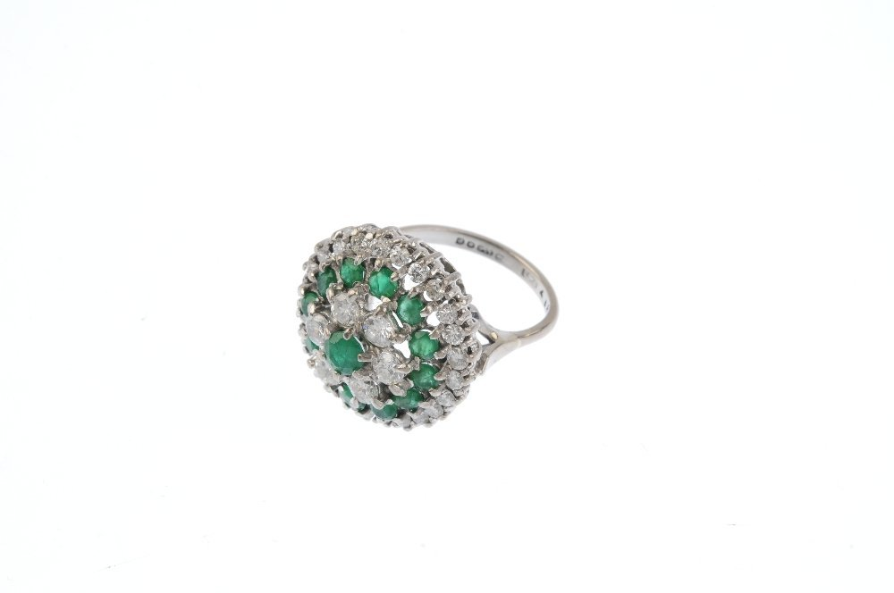 An 18ct gold diamond and emerald cluster ring. The - 3