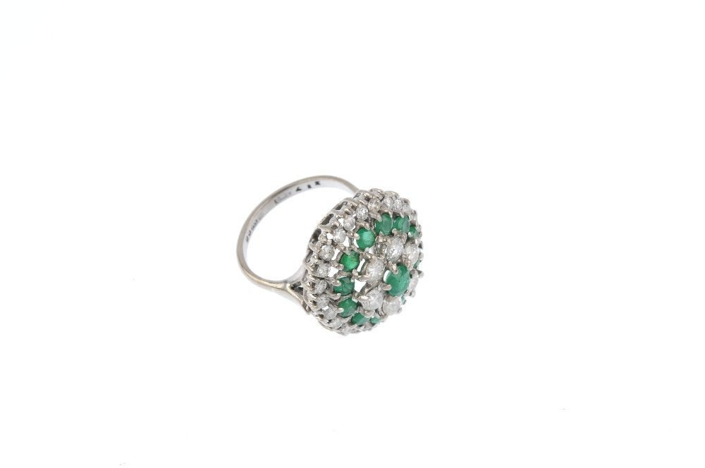 An 18ct gold diamond and emerald cluster ring. The - 4