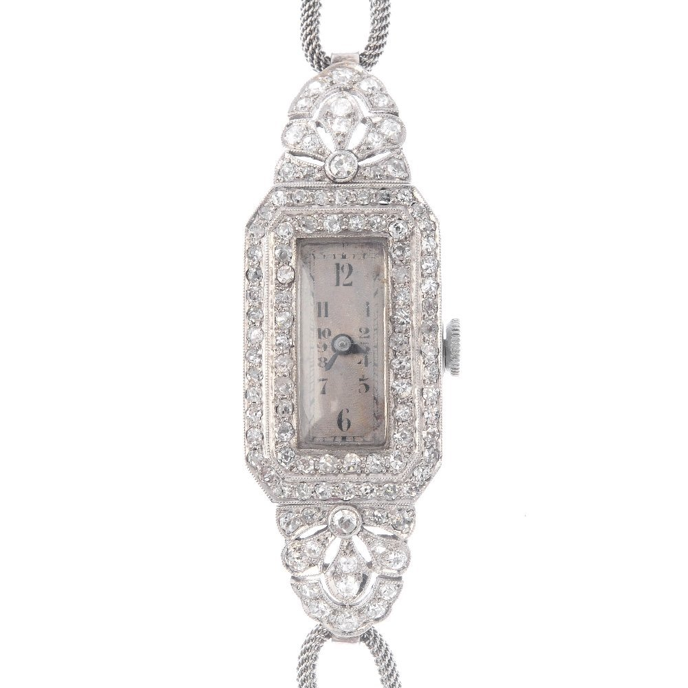 A diamond cocktail watch. The rectangular-shape cream