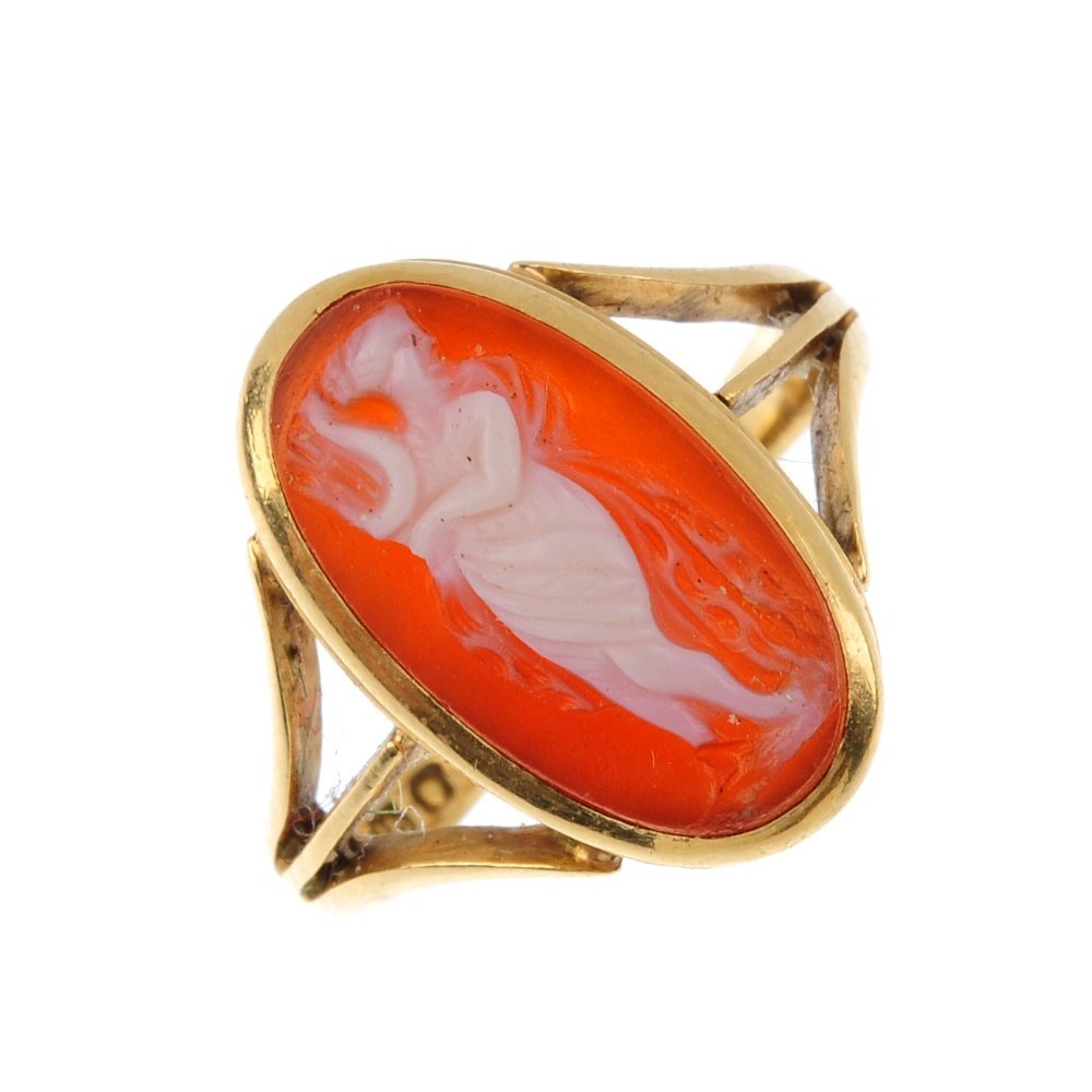 An Edwardian 18ct gold cameo ring. The marquise-shape