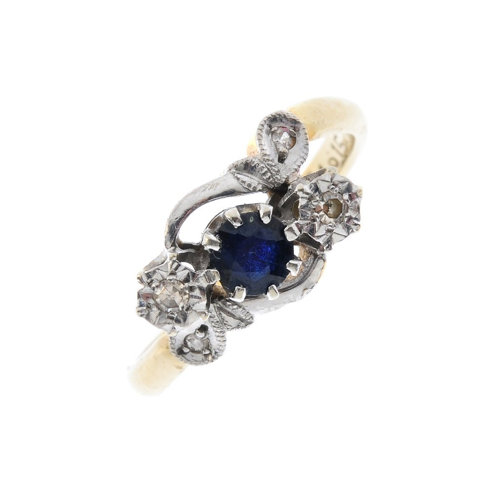 An 18ct gold sapphire and diamond crossover ring.