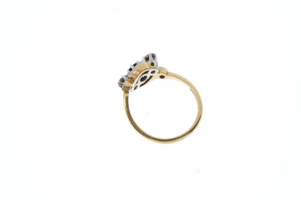 An 18ct gold sapphire and diamond crossover ring. - 2