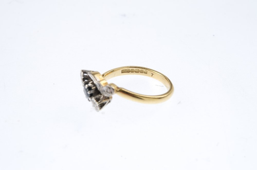 An 18ct gold sapphire and diamond crossover ring. - 3