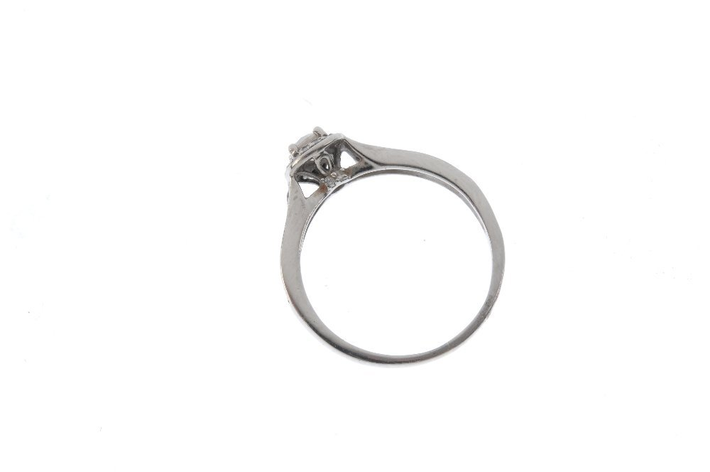 A palladium diamond single-stone ring. The - 2