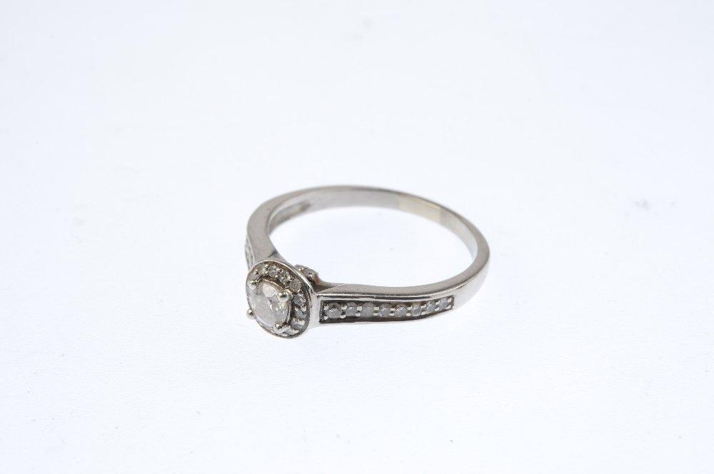 A palladium diamond single-stone ring. The - 3