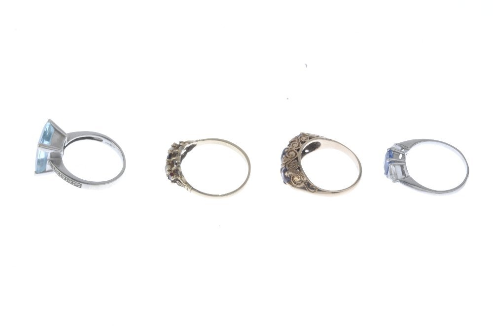 Four 9ct gold gem-set rings. To include an alternating - 2