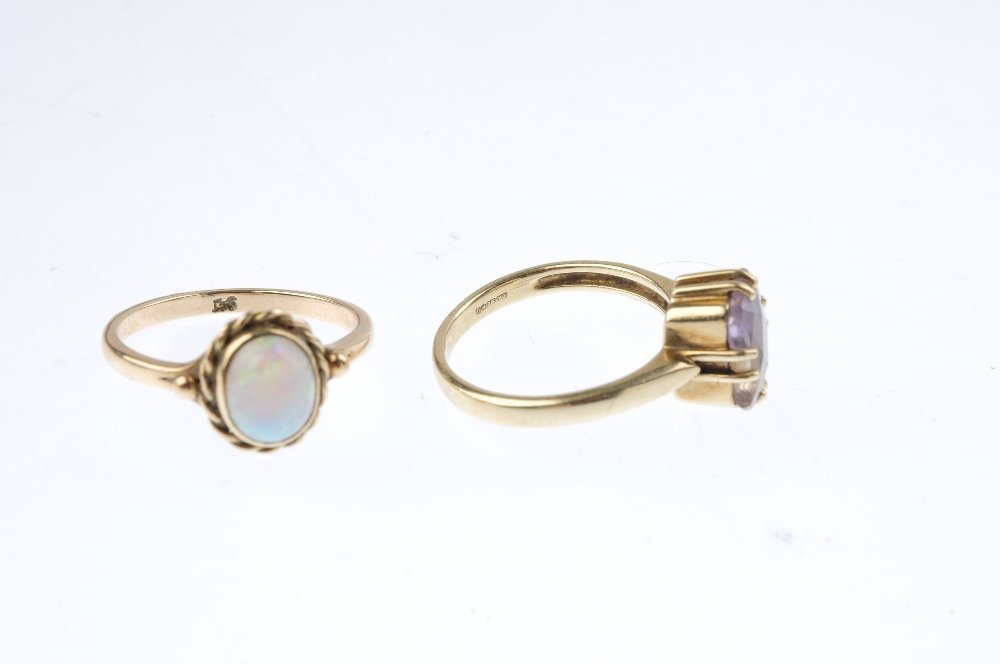 Four gem-set dress rings. To include a 9ct gold - 3