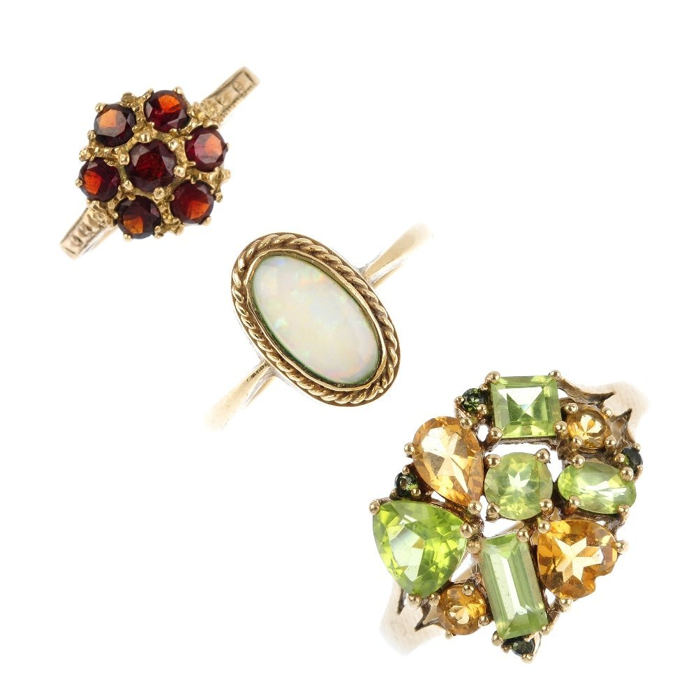 Three 9ct gold gem-set dress rings. To include an opal