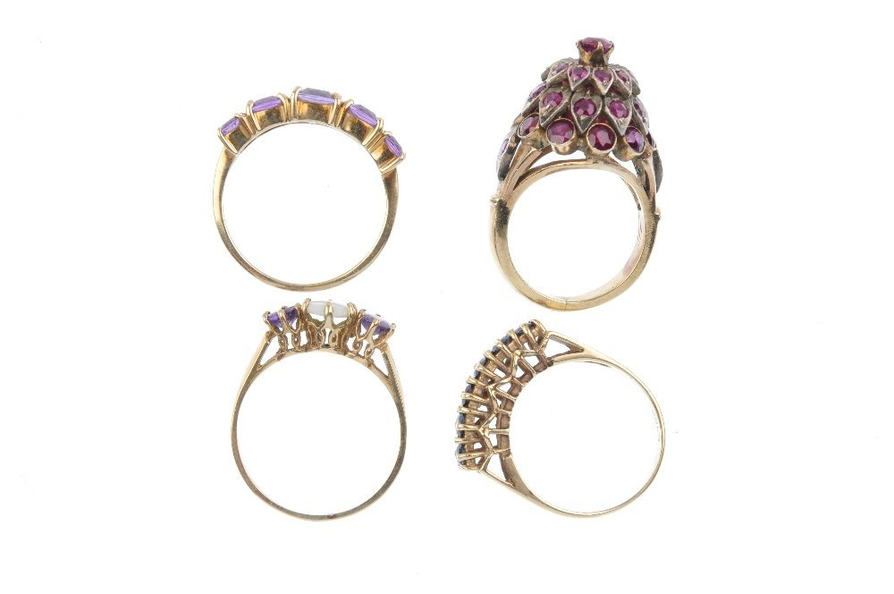 Four gem-set dress rings. To Include a 9ct gold - 2