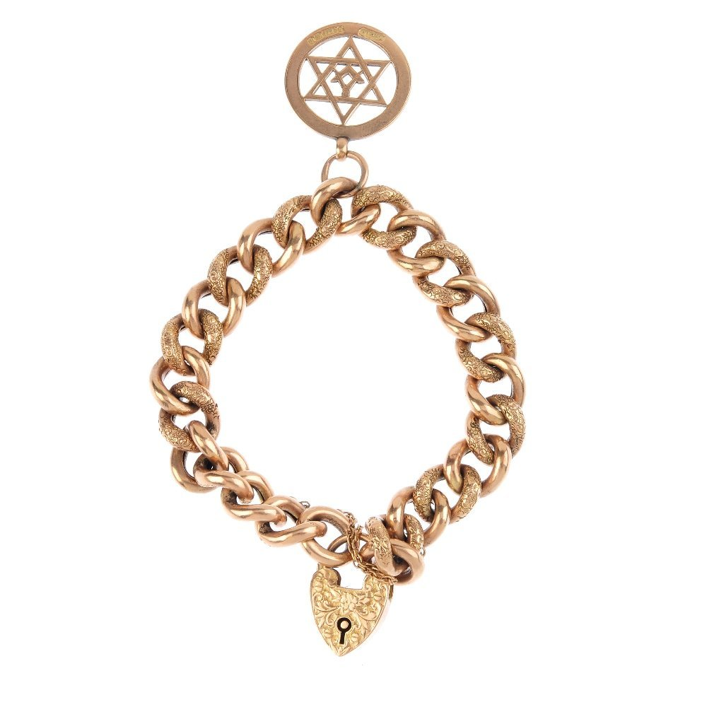 An Edwardian 9ct gold bracelet. Designed as a series of