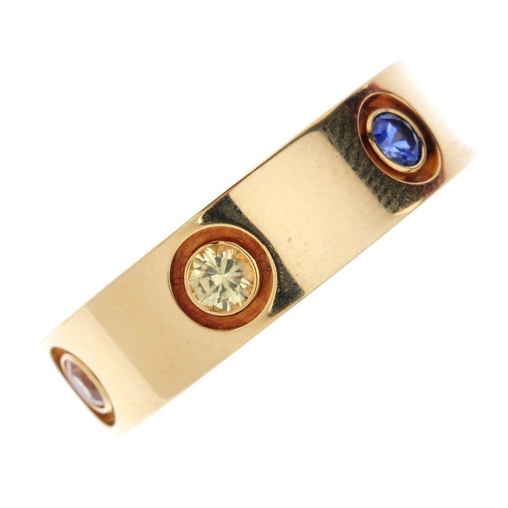 CARTIER - an 18ct gold multi-gem 'Love' ring. Designed