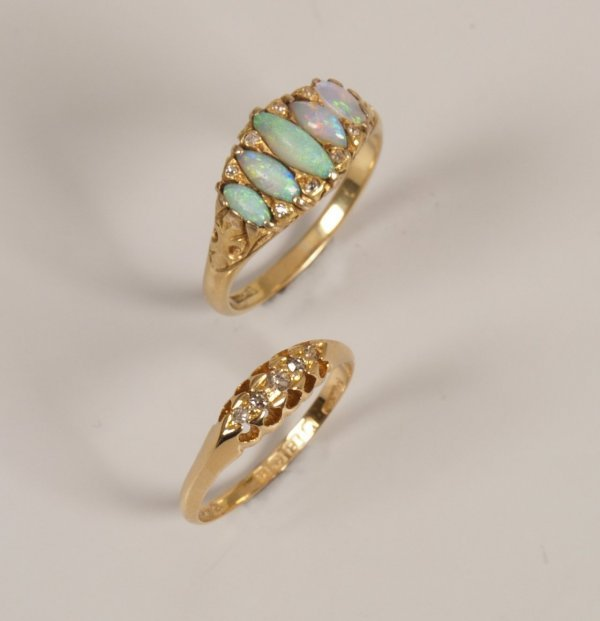 6: Edwardian 18ct gold dress ring set with navette opal