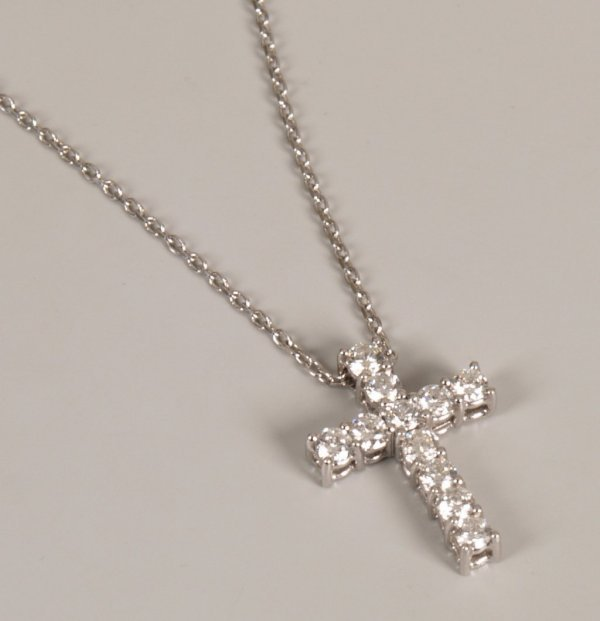 10: 18ct white gold cross pendant set with eleven round