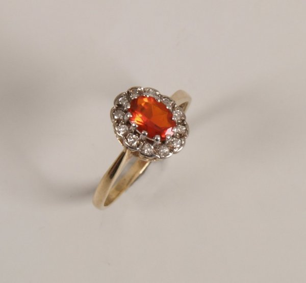 20: 9ct gold fire opal and diamond set cluster ring, wi
