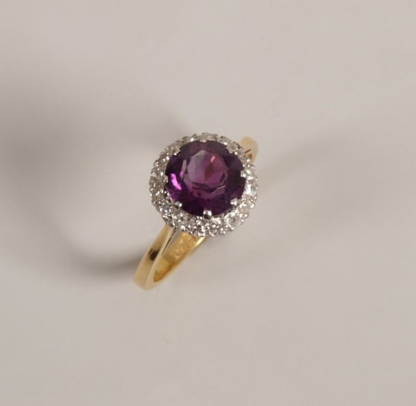 22: 18ct gold and platinum amethyst and diamond cluster