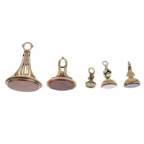 Five fobs. The first a carnelian fob of oval outline,