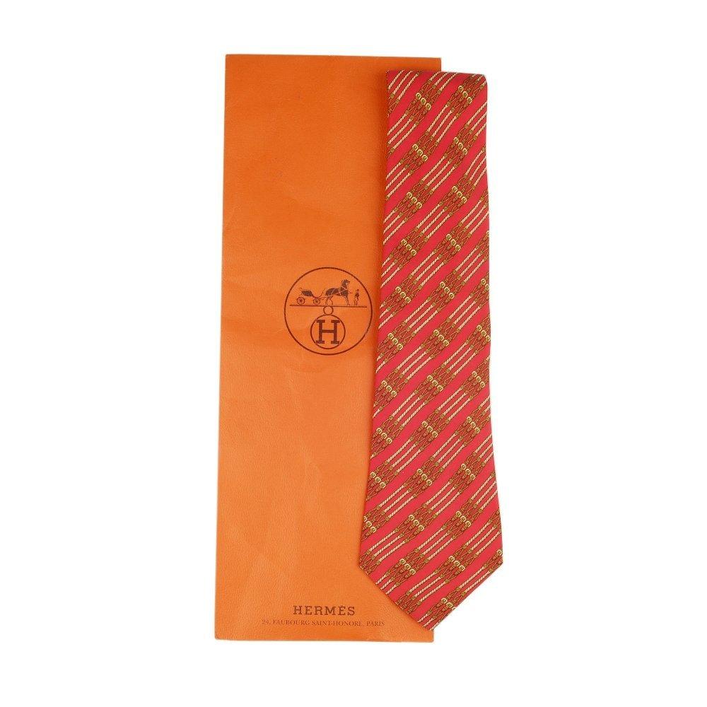 HERMÈS - a silk tie. A red coloured equestrian themed