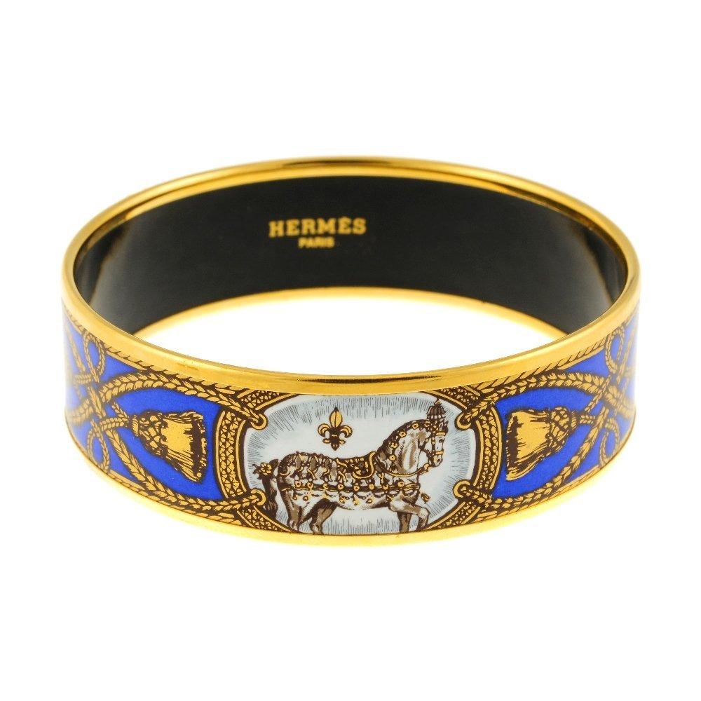 HERMÈS - an enamel bangle. Depicting three white horses