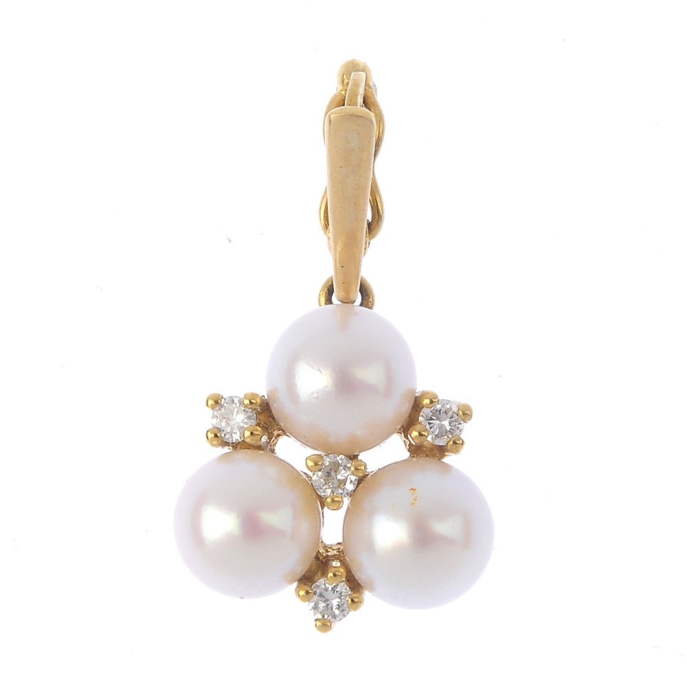 A 9ct gold cultured pearl and diamond pendant. The