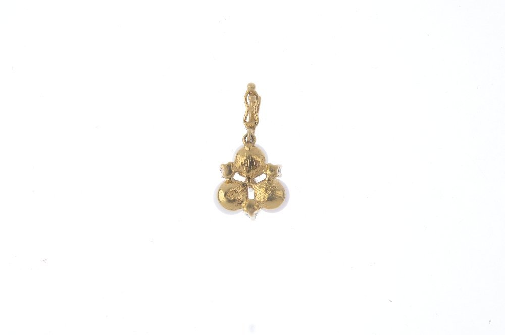 A 9ct gold cultured pearl and diamond pendant. The - 2